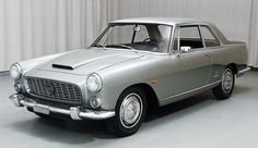 The 1964 Lancia Flaminia Coupe boasts sharp-edged styling by Pininfarina.