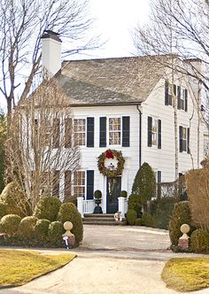 Boxwoods, urns, white house, black shutters - Christmas in Southampton
