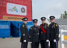 Members of the OPP Ceremonial Unit raise the flags during the Pan Am Games Equestrian events. July 12, 2015