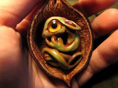 Little clay dragon necklace in a walnut shell.