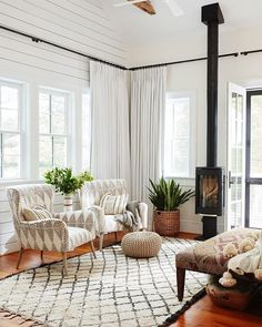 The shiplap paneling and hand-hewn beams salvaged from a shed are our favorite standout qualities of this cozy sunroom. Let's not forget… Sunroom Window Treatments, Sunroom Windows, Scandinavian Window Treatments, Four Seasons Room, Three Season Room, Standing Fireplace, Small Fireplace, Fireplace Ideas, Better Homes And Gardens