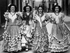 Vintage photo of four ladies in flamenca dress.