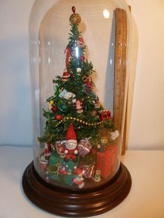 VINTAGE DOLLHOUSE MINIATURE GLASS DOME CHRISTMAS TREE WEST TRIM ORNAMENT. Similar to mine. I cherish it.  My mother made it many years ago.