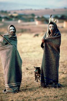 Africa | Adolescents from Pondoland in Transkei. Their faces are painted white and they are swathed in blankets as part of puberty rights.   South Africa | ©United Nations