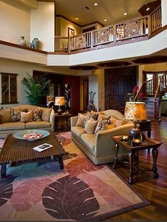 Maui Hawaiian Home Tour - The Hawaiian Home hate the furniture and decorating.. LOVE the carved doors and wood floor and staircase! Oh that balcony!