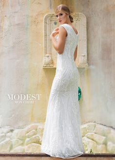 bd295351 Mon Cheri Bridals TR11842. This unique dress features all over sequins in  the lace that