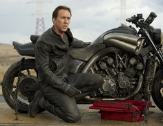 Ghost Rider Bike: Nicolas Cage Next to the Hell Cycle (Yamaha VMAX) - the Prop Motorcycle from Ghost Rider: Spirit of Vengeance Ghost Rider 2, Ghost Rider Motorcycle, Ghost Rider Marvel, Motorcycle Leather, Biker Leather, Motorcycle Bike, Leather Men, Leather Jackets, Leather Boots