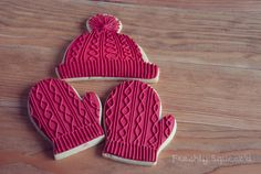 Red knitted tuque and mittens.  Royal Icing decorated sugar cookies for Christmas.  by Letterpress Bakery