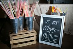 glow sticks necklaces and bracelets for wedding departure. wedding chalk board, crate, galvanized metal
