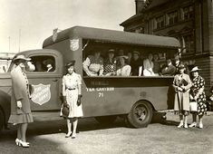 Ladies from the General Office, Toronto, Ontario, presenting a Mobile Tea Canteen to the Salvation Army for the war effort on June 25, 1941....