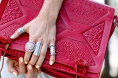 pale yellow nails delicious tooled red bag and silver ring abundance