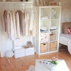 i like the idea of hanging your clothes outside of the closet...at least some of them. ;)