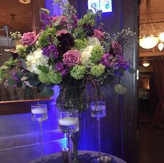 A beautiful center piece surrounded by floating candles. #wedding #event #centerpiece #inbloom #floral #powerstationevents #ctwedding
