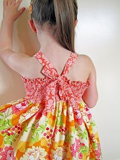 Dress tute - shirring and straps would be adjustable.  Ambitious pattern for me but a cute dress!  Other tutorials avail. at  her blog From an Igloo.