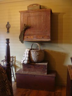cute hanging cupboard, A basket round basket.W/ lidded box sm- med,  then on a larger  Looked great.