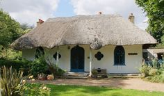 Vintage Cottage: The Hermitage, a Gothic style thatched cottage with an ogee arched door. Hanwell, London. Circa 1809. Photo Credit: Wikipedia