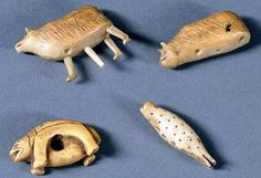 Inuit ivory effigy carvings.