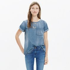 A short-sleeve denim tee with a perfectly worn-in look. Fun fact: The shirt is sewn and stonewashed before a member of our jeans team lets down the hem by hand, creating a cool raw-edged finish. <ul><li>True to size.</li><li>Cotton.</li><li>Dry clean.</li><li>Import.</li></ul>