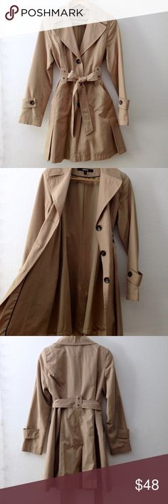 DKNY Double Breasted Trench Coat Cool camel colored double breasted button up waterproof trench coat with front pockets, tie belt, and super soft inner lining. Perfect trench, but I've grown out of it. DKNY Jackets & Coats Trench Coats