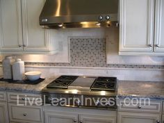 kitchen countertops and backsplashes | Looks like 4″ granite tiles with white border and inlays