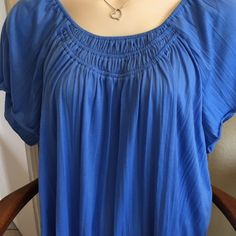 "ON HOLD So soft and comfortable. Elastic around neck but very loose. A ""longer"" short sleeve, bell type. Flowing loose pleats all the way down hide some of those lumps and bumps that we try to hide quite often!!!  100% polyester that's soft to the body. 27 1/2"" long, approximately. Wore once and cleaned. Comes out great!!  30% off any 3 items. What a fantastic deal!. Questions?  Just ask. Ready to purchase? You know what to do. Thanks for coming into my closet and have a beautiful day! ☀️…"