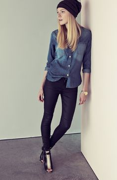 For a downtown-cool look, pair a chambray shirt with coated denim. Then add a beanie, a boyfriend watch, and heeled booties.