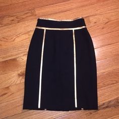 Escada 24 Carat Gold Black Skirt 36 EUC Piping exc Absolutely stunning skirt! This is insane! I wish it fit me but alas I must sell it. Worn once, no issues, like new! Beautiful gold pining on a wool black. Size 36 = Small/6 Escada Skirts Pencil