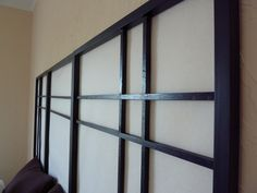 In order to make our own queen-sized shoji screen head board, we cut some wood and gave it a few coats of wood stain .   Next, let's add the...