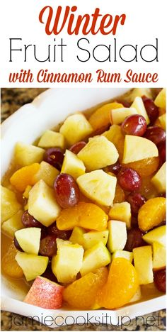 Winter Fruit Salad with Cinnamon Rum Sauce. A perfect side dish for Thanksgiving or Christmas Dinner. Also perfect to take along to a holiday party.
