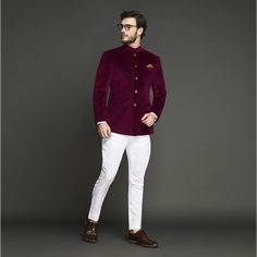 Signature Maroon Velvet Jodhpuri Suit | The only thing better than a maroon velvet Jodhpuri suit is a maroon velvet Jodhpuri suit that comes with luxurious buttons from Jaipur. Crafted from Italian uncrushable velvet fabric, the suit is paired with white pants made out of Italian milled long staple cotton. This suit comes with a Velvet Jacket and a Cotton Trouser. #groomsmen #indianwedding #custom #jodhpuri