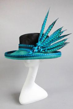 66dafcacb46 Black blue and green sinamay hat with ton sur ton feathers size 58