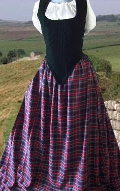 "Majestic Velvets Costumes.  4 pc. Scottish dress: velvet bodice, plaid skirt, hoop, and cotton chemise (short or long sleeve, drawstring neckline, hip length).  The velvet bodice has side lacing w/ 20 grommets (laces on both sides) and modestly panels for expandability, 10 bones or stays (6 down front, 4 on sides), and lined w/ thick cotton canvas-like fabric.  Skirt is poly/cotton blend plaid, 115"" circumference at bottom. Black w/ red plaid, or Hunter w/ navy & green plaid."