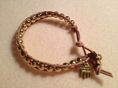 Natural leather with gold beads, HAND MADE charm attached.