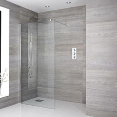 Recessed walk in shower with round chrome shower head and arm, glass screen, and black shower tray Wet Room Bathroom, Wet Room Shower, Bathroom Wall Panels, Bathroom Shop, Big Bathrooms, Small Bathroom, Bathroom Towels, Walk In Shower Enclosures, Shower Systems