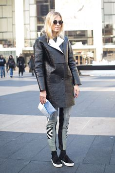 interesting leather in a wonderful modern cut, graphic black and white striped & color blocked pants, wonderful platform flats