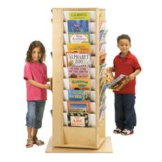 Perfect for classrooms, libraries, or family dens, the Jonti-Craft Revolving Literacy Tower Bookcase - Large is truly the happy giant of learning. Book Display Stand, Book Displays, Waiting Room Design, Family Den, Atelier Creation, Thing 1, Classroom Organization, Classroom Setup, Organizing