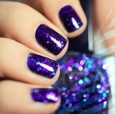 glitter polish is NCLA's Prized Possessions and from the original text on this pin, it sounds like this glitter might be layered over OPI's Yoga Ta Get This Blue
