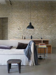 sofas in heavy washed linen slip covers (fabric from Rough Linen http://roughlinen.com) and rustic wood with contemporary industrial architecture