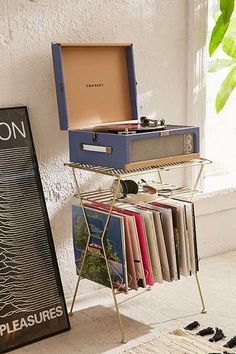 Metal Vinyl Storage Shelf - Urban Outfitters PLUS the record player. My New Room, My Room, Storage Shelves, Storage Spaces, Shelf, Music Corner, Vinyl Record Storage, Diy Vinyl Storage Rack, Rack Design
