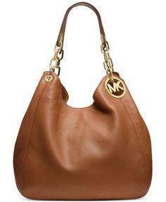 MICHAEL Michael Kors Fulton Large Shoulder Tote $398.00 It's love at first sight with this effortlessly chic shoulder tote rendered in rich Venus leather. Gilded logo medallion detailing adds signature style, while the trio of interior compartments keeps you organized anywhere. By MICHAEL Michael Kors.