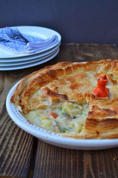 A gloriously golden puff pie filled with a selection of vegetables in a rich cheese sauce. Veggie & Vegan recipes www.tinnedtomatoes.com