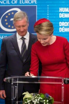 Belgium's King Philippe and Queen Mathilde sign the golden book at the Council of Europe in Strasbourg, eastern France, Tuesday, April 21, 2015. The royal couple is in Strasbourg for a one day visit.