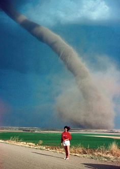 I'd say who would take a picture in front of a Twister, then I remembered where I'm from and that half of the residents of Oklahoma would do the same thing. Hell, I might do it if there was a fast accelerating car nearby for a quick get away.
