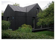 Grey/black exterior industrial/rustic home in Latvia. Very clean.