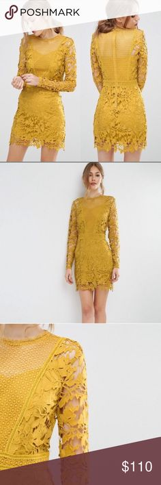 ASOS Yellow Lace Dress This is a beautiful marigold yellow dress by ASOS featuring multiple lace patterns, long sleeves, and other romantic details. It comes with a yellow slip. Asos Dresses