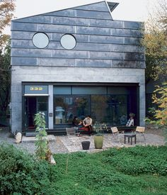 The couple's dream home features porthole windows and unfinished wood, steel and concrete. Photos by Philip Newton.