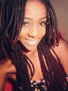 Long locs that just happen to accompany a beautiful smile.