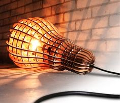 Laser Cut Plywood Lamp by Barend Hemmes - a pendant light shaped like a giant light bulb?  Cool!  Love the laser cut wood cage!!