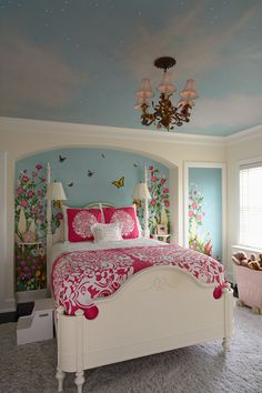 wall mural and high ceiling painted like the sky with a beautiful chandelier perfect for a girls room
