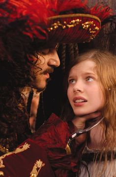 *CAPTAIN HOOK ( played by: Jason Isaacs) and WENDY (played by: Rachel Hurd-Wood) ~ Peter Pan, 2003